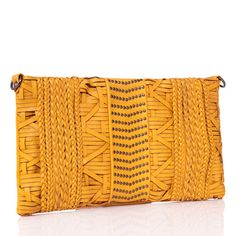 Shake up your style this season. Rather than relying on a stand-by shoulder bag, push the envelope with Investigator. Flat studs and a heavy chain strap create a clear constrast against the Native American-inspired woven exterior with braided accents. The streamlined shape keeps the style modern, but the reasonable size can only hold a few indispensable items. Add this accessory to your outfit for a final fashionable flourish.