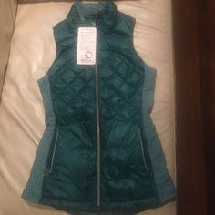Lululemon Down for a Run Vest Size 4 Forage Teal Brand new with tags Lululemon Down for a Run Vest in Forage Teal. Never used. There are no stains, tears, rips, holes, or pilling. All zippers are functional. Clean inside and out. Rip tag is attached. Reasonable offers welcome but no trades please as I am in need of funds. Will ship the same day or next day (weather permitting). lululemon athletica Jackets & Coats Vests
