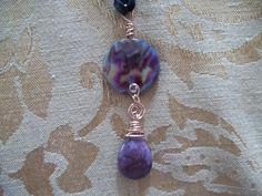 natural purple stone with copper