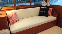 Molly Whopper settee fabricated with Ultraleather and accent pillows made with Sunbrella fabrics, Crystal Coast Interiors
