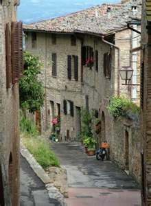 Visit a Tuscan Italian Village and eat in an authentic Italian restaurant.