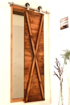 Did you ever think about using barn door shutters as window covering in your home? See: http://rusticahardware.com/?s=shutter