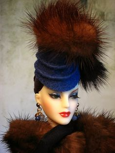 There is nothing more synonymous than sumptuous fur and Madra Lord. OOAK hat and earrings are from The Couture Touch, fur drape from miniature furrier PD Root, gloves from Ashton Drake. Auburn wigcap was borrowed from J'Adore Gene Marshall.
