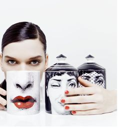 Setting the mood with sweet smelling scents, Fornasetti wraps candles in porcelain with a hint of red, adding the finishing touch to the perfect entertaining environment.