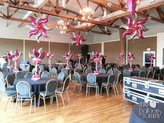 Pink and silver foil balloons hang from the ceiling and top the centerpieces Balloon Stands, Balloon Arch, Balloon Garland, The Balloon, Balloon Ideas, Metallic Balloons, Foil Balloons, Balloon Ceiling Decorations, Hanging Balloons