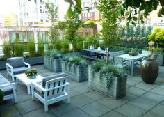 See how this 900 square foot concrete rooftop was transformed to this cool space