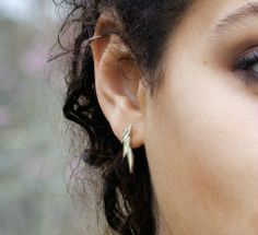 'Swoosh' earstuds in polished silver £48 http://www.andreaeserin.co.uk/collections/swoosh-linearleaf