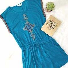 "Umgee Teal Southwestern Tee Dress Toss it on like a tee, perfect with gladiator sandals or even leggings! Ribbon detail around arms, vintage boho feel in the cross stitching on the bodice. High quality, well made by Umgee USA. Small: Bust 16 1/2"" Waist (unstretched) 14"" Medium: Bust 17 1/2"" Waist 15 1/2"" Large: Bust 18 1/2"" Waist 16 1/2"" ChicBirdie Dresses"