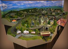 "This is our 10'4"" x 10' HO gauge/scale realistic fantasy custom model train layout in Northern New Jersey.  At Dunham Studios, we specialize at creating custom model railroads, custom train layouts, custom model railways, model accessories and more for over 50 years."