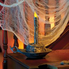 Your Halloween guests will be amazed by the Floating Candle Halloween Prop. This cool haunted Halloween candle will have everyone asking where you got it! Sound activated, it mysteriously floats across a flat surface, plays spooky music, and lights up.