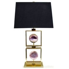 Hand made table lamp with exceptional Brazilian agate specimens in rare, in-tact sphere shapes. supported within stacked brass squares.