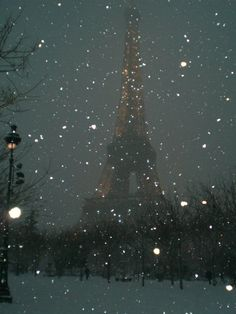 paris in the dark falling snow.