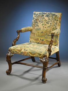 This exquisite George II-period library chair is an exceptional example of early Georgian design. This char was once part of the collection of renowned collector Benjamin F. Edwards III Called a Gainsborough chair, it is crafted of Cuban mahogany and upholstered in period tapestries. Its design is marked by impeccable Neoclassical carving and a perfectly proportioned structure. Circa 1745