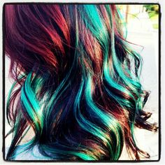 Green dyed streaks in red hair