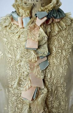 Victorian dress detail: lace, trimmings, ribbons. 1874-1877 cotton and silk Peignoir details, French.