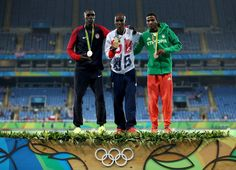 (L-R) Silver medalist Paul Kipkemoi Chelimo of the United States, gold medalist Mohamed Farah of Great Britain and bronze medalist Hagos Gebrhiwet of Ethiopia stand on the podium during the medal ceremony for the Men's 5000 meter on Day 15 of the Rio 2016 Olympic Games at the Olympic Stadium on August 20, 2016 in Rio de Janeiro, Brazil.
