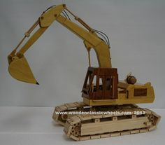 """1971 Case excavator  What an unbelievable piece; tracks turn 360,   Body swings 360, hydraulic hoses.  Body unit leans right & left  this is a custom built model that every excavation company & or collector must have.   Put your company logo on this one to show your company pride.  Built from: satinwood yellow color from Brazilian, Brazilian Cherry for the cab solid birds eye maple tracks, and black walnut accent     approx. size 18"""" Long X 20"""" Tall X 11"""" Wide"""