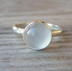 Luminous. Dreamy. Fabulous. That's my take on the lovely Dew Drop Moonstone ring by OneGarnetGirl at her shop on Etsy. Ring features a 10mm (slightly less than 1/2 inch) white moonstone cabochon and bezel set in a sterling band. Available...