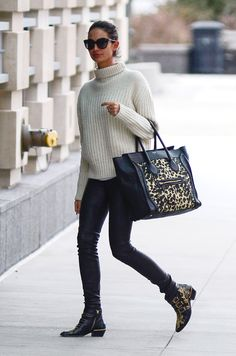 Chic Is: Pair a sweater with easy black pants and a carry-all for jet-setting style