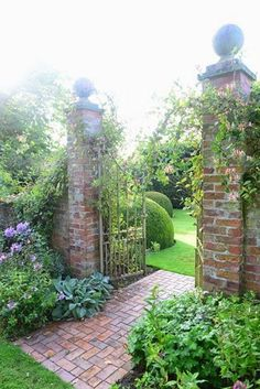 garden gate...with brick pathway. This is not at all the style of my house but if it were then I would love to have this gate.