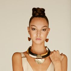 Handmade necklace made out of brass and leather. The brass is cut and polished by hand, then coated with protective finish to prevent tarnish.