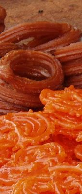 Zlabia - Iraq version of jalebi (fried funnel cake sweets, soaked in syrup)
