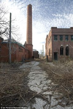 North Brother Island - A road leads between the morgue to the right and the physical plant and coal house to the left.