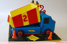 Dump Truck Birthday Cake by Pink Cake Box in Denville, NJ.  More photos at http://blog.pinkcakebox.com/monster-truck-birthday-cake-2007-03-25.htm  #cakes