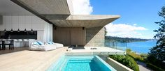 Canadian firm Mcleod Bovell Modern Houses has recently completed this waterfront home in West West Vancouver, British Columbia, in order to make the most of its sea views.The home's irregular shape traces the site boundary, coming to an angled blinder that provides privacy from tight adjacent properties. A natural, minimalist palate of raw concrete, steel, …