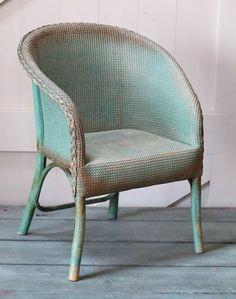A child's Lloyd Loom armchair
