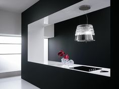 A kitchen that is modern, elegant and dramatic