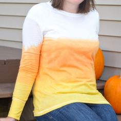 You can dress up for Halloween without the costume! Try this DIY dip-dyed candy corn T-shirt tutorial for a subtle Halloween look.