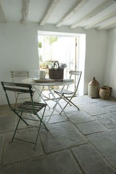 dining area simplicity with beautiful stone floors @carolinearber