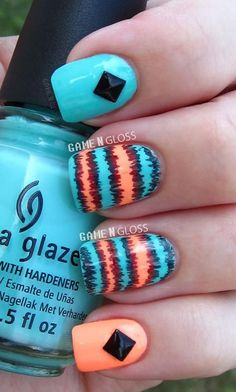 A combination of melon and sky blue polishes to form an abstract design. To make the nails stand out even more embellishments have been added on top.