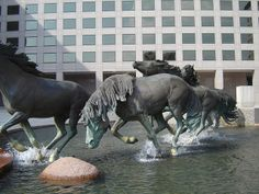 horsing around dallas n irving - bronze horses running in the plaza