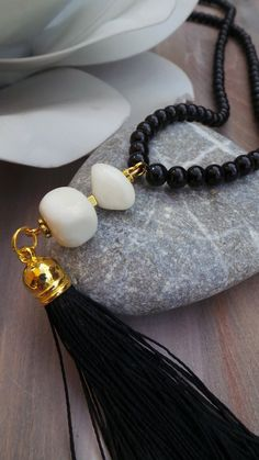 Long tassel necklace with black glass pearls and jade gemstones. Black and white…
