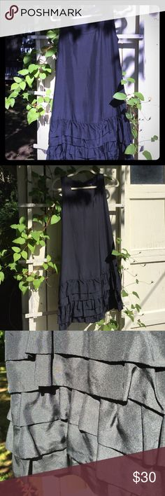 Navy Blue Silk Dress This dress is special! It is 100 percent navy blue silk with a poly lining. It has a slight racer back with a tabbed zipper and hook closure. Layered ruffles adorn the hemline. Believe it or not, this is a Gap dress! Shocking, I know. Beautiful. Size small. Gap Dresses