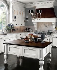 "the ""Hamptons"" apparently has their own magazine. Beautiful kitchen!"