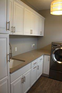 laundry room with bertch cabinets in a white thermofoil door bertch cabinets tiny laundry
