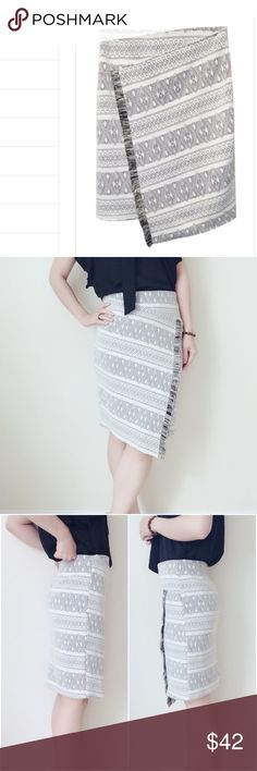 """Ivory/Black Faux Wrap skirt Very clean and elegant skirt. Ivory with black knitting pattern.The front Looks like wrap but actually sealed. Lightweight. Good for both work and party. True to size. (Model size S, wearing S, 5'5""""). 🇺🇸Made in USA. Brand new with hanger and plastic bag. 💟dry clean or gentle hand wash 🚫no trade Potter's Pot Skirts"""