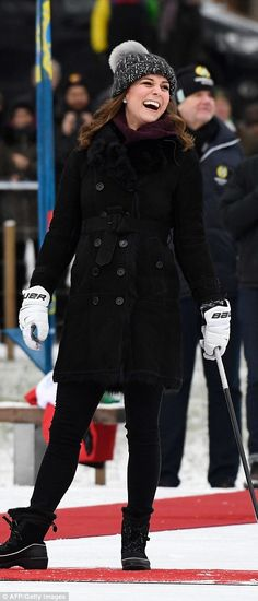 Kate's coat is the Burberry Toddingwall Shearling Trench Coat. Kate's sweater is by Swedish brand Fjällräven. Kate's boots are by Sorel. (info from http://hrhduchesskate.blogspot.com/2018/01/first-look-william-and-kate-arrive-for.html?m=1)