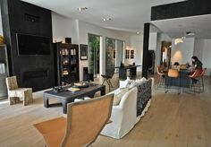 Black fireplace surround/wall with flatscreen and fireplace