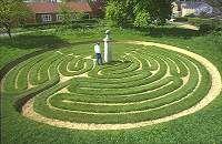 Located on the village green in Hilton, Cambridgeshire, England.  This 9-circuit labyrinth was built in f1660 and is a classic turf labyrinth.