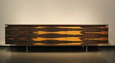 These exotic wood cabinets by Berlin based designer Thilo Mayr have me drooling. I have a special place in my lusting for rosewood and these veneers are