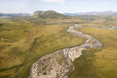"""A breathtaking aerial view of the Gates of the Arctic National Park and Preserve in Alaska. This photo was taken by Student Conservation Association intern Devdharm Khalsa, who got to see the park in most spectacular fashion while documenting the work of a National Park archaeology crew this summer. """"The sight I saw as we helicoptered into the park was awe-inspiring. Pristine rivers — the surface glittering like thousands of diamonds — flowing hundreds of feet below us, vast mountain ..."""