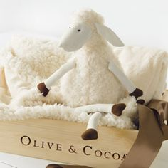 "Cozy cuddling sends baby straight to sweet sleep. A fuzzy sheep snuggles next to baby to keep them company while a luxurious ivory colored reversible chamois blanket wraps them up tight.  Sheep measures 16"" tall, blanket measures 30"" x 36"" and both come gift wrapped together in a hand crafted wood crate with ribbon."