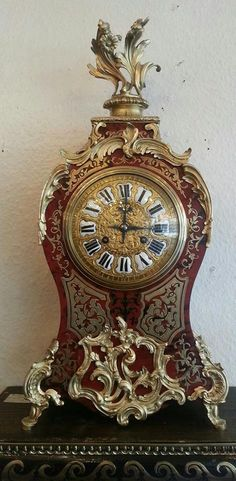 A 19 Century French Boulle and Ebonised Bracket Clock . with guilt floral mounts . www.snowdoniaantiques.co.uk