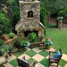 Nice cozy party area, but I would use the fireplace for grilling instead of sitting flowers in it.