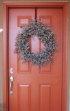 creatively christy: Christmas Wreath Make-over (good christmas color on wreath for an orange door!)