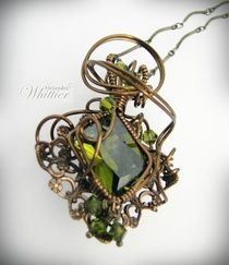 SOLD .Olivine cubin zirconia wire wrapped with antique brass wire and mounted in an antique brass filigree, olivine swarovski crystals accents.   www.stonedisegno.com